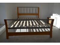 A modern double bed frame, no mattress, excellent!