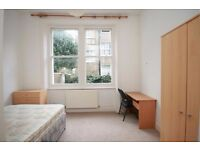 LOVELY TWO BEDROOM FLAT WITHIN MINUTES WALK TO BARONS COURT OR WEST KENSINGTON STATION AND SHOPS