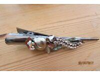 Diamante/flower hair clip, peach/gold mix, really pretty.