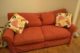 Red 3 seater sofa, armchair and floral poof