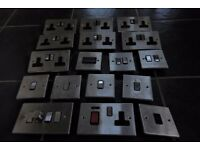 Assortment of brushed metal face plates for socket boxes