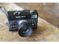 Rollei 35S film camera, Sonnar 2.8 40mm lens, hood, BW filter, case, wrist strap