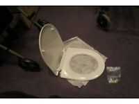 Hardly used White Soft Close Toilet Seat with fittings