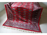 Lovely hand-knotted Bokhara oriental rug or carpet, 8' x 5', red