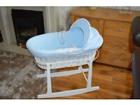 Pale blue and white baby crib and rocker stand