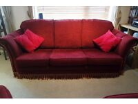 Beautiful well maintained three-seater sofa with two armchairs and a leg rest