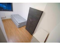 Room available in New Building, NEXT TO STATION!