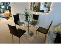Round Glass Dining table and Leather chairs