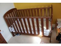 Solid wood cotbed less than 6 months old
