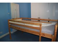 Solid Pine Cabin bed with mattress.Good condition.Height 96x207cm length.