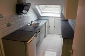 Newly renovated 2 bedroom top floor flat above a shop on Chamberlayne Rd