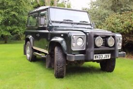 Green Land Rover Defender 90 TD5 XS.