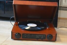WOODEN RECORD PLAYER/RADIO BUILT IN SPEAKERS CAN BE SEEN WORKING