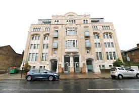 Two bedroom flat with private underground parking in Grade II listed building