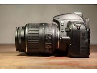 Nikon d3100 CAMERA with 18-55m lens and battery charge and strp.