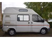Camper van with solar panel, awning, portable toilet and cover needs work done.