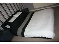 Double Bed £95 - Black faux leather designer bed frame with curved profile and sprung slatted base