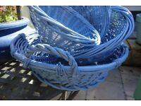 A quartet of circular wicker baskets in blue