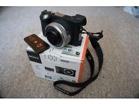 Sony A6000 + 16-50 lens + £150 in accessories + Warranty + SDHC LEXAR 32gb