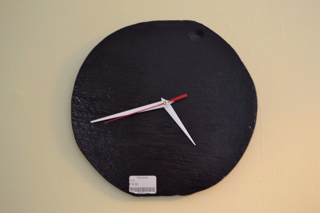 Circular black slate wall clock