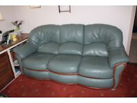 Green Leather Three Piece Suit. One Arm Chair has an Electric Foot Rest