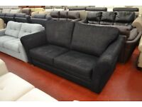 Brand new, high end sofa in black fabric