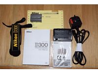 Nikon D300 with battery grip and 2 batteries with 16500 actuations