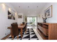 SHORT LET - Earls Court Road W8. Exceptional two double bedroom, two bathroom flat to rent.