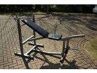 Olympic weights bench with added leg extension attachment. Incline, decline, flat. Folding