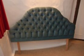 Vintage retro bedstead for a double bed covered in blue velvet
