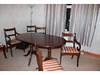 Extending Dining table 4 chairs and 2 Carvers,