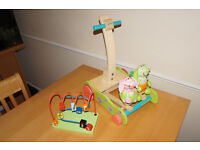 Interactive wooden walker and activity toy.
