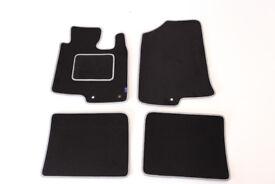 Car mats for Hyundai i40. Black with grey trim and heel pad.
