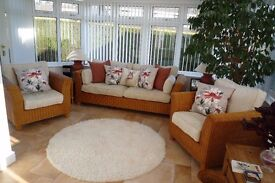 Rattan cane suite and two glass topped cane side tables