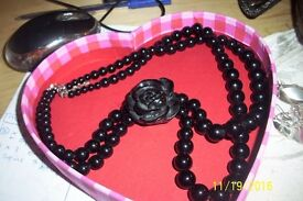 Ladies hard black plastic/bakelite beaded necklace with large black rose