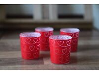 4 shot glasses with hearts pattern