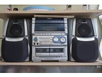 Compact stereo system with two speakers, remote control and Karaoke microphone