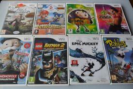 8 Nintendo Wii games Batman Monopoly Mickey Mouse etc