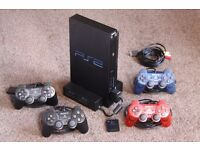 PS2 + 4 controllers + Multiplayer Adapter + Memory Card