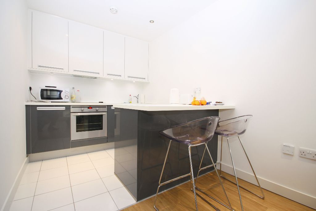 one bedroom apartment with a balcony, inclusive 24hr concierge service and gym