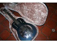 Wooden bodied regal resonator guitar