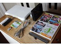 Nintendo Wii with 5 Games 2 Controllers and Wii Fit Board