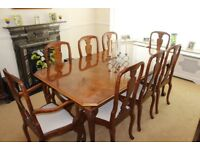 Dining table with 6 chaires and two carvers plus sideboard.