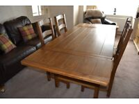 Solid Oak Extending Dining Table and Four chairs & Large Mirror Sherry Bros Rossmore