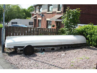 16ft Fibreglass Row Boat with oars, rowlocks and boat carrier. Needs work but a great project.