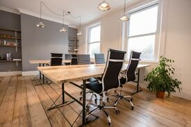 2 large industrial wooden desks and 8 office chairs