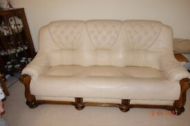 Cream buttoned leather three seat sofa and matching chair