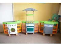 Smoby toy kitchen set includes oven, washing machine, ironing board and sink.