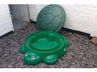 Turtle themed sand pit with bag of sand