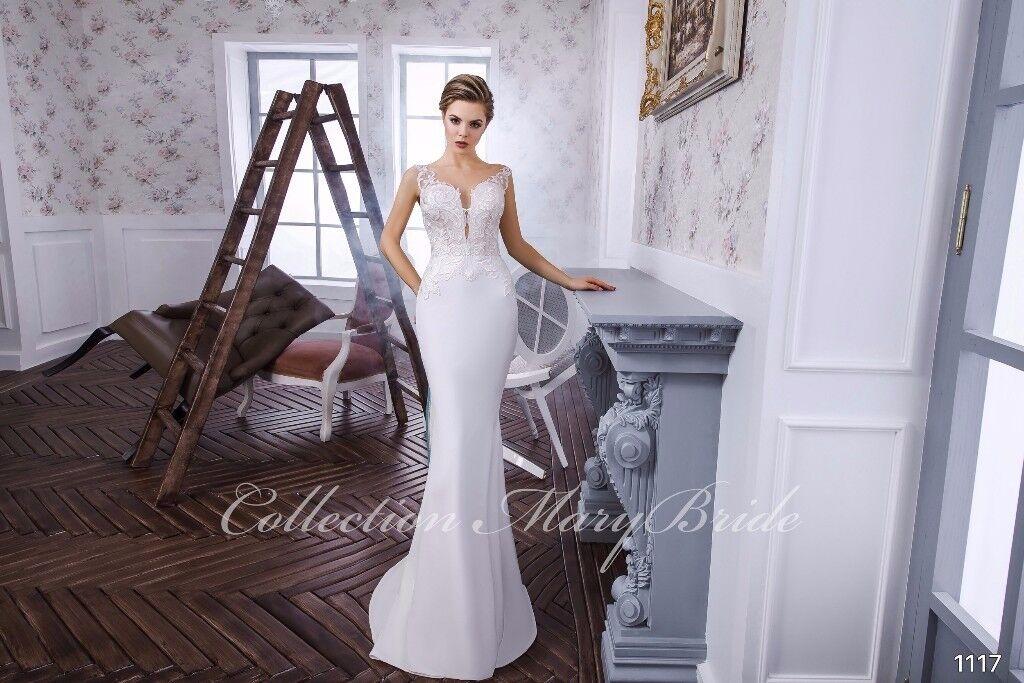 brand new designer mermaid wedding dress. unique. not found anywhere.